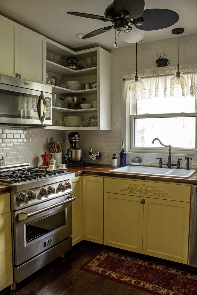 My yellow and white kitchen with its butcher block countertops and white subway tile makes me smile.