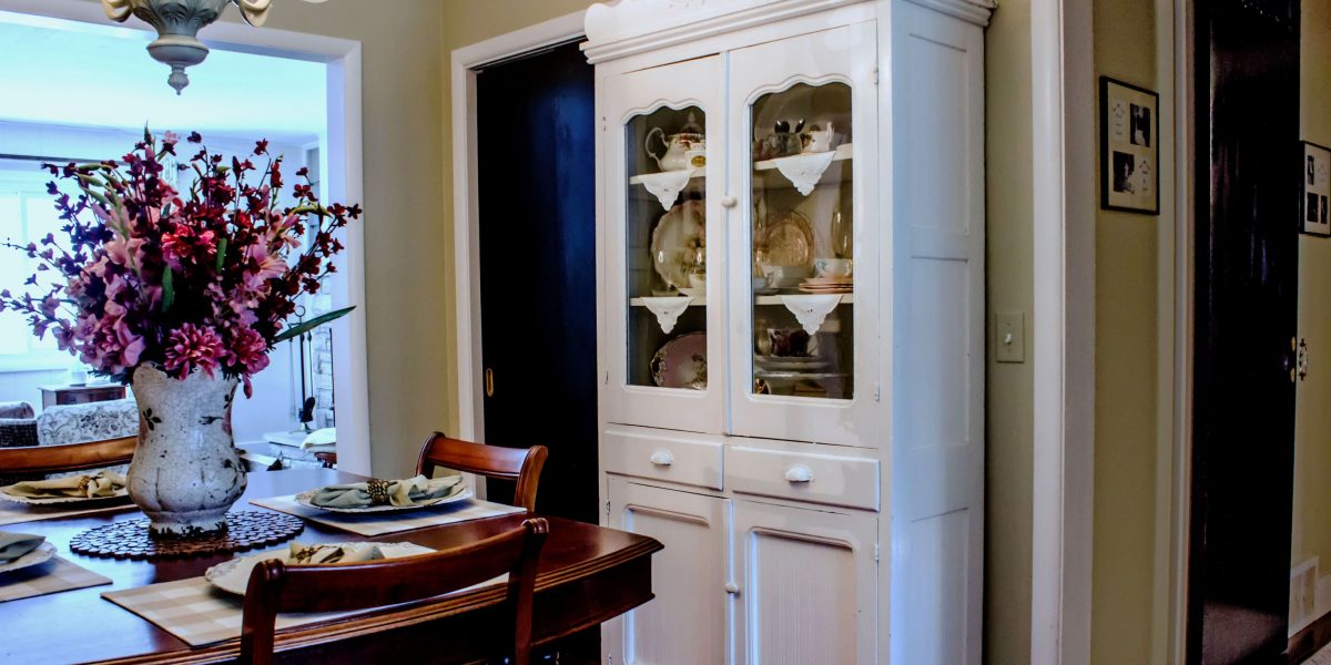 White China cabinet in dining room