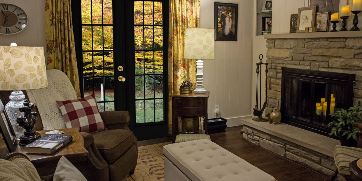 Black french doors and fireplace in lounge room.
